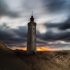 One of our favorite accounts on Instagram is @Ttspot. Check him out for more of his amazing landscape photos! @Ttspot  Conversations with the light. The old lighthouse, Rubjerg knude in the north of Jutland, Denmark.