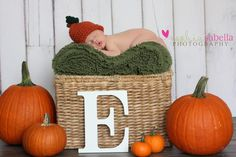 Apples and pumpkins and initials.