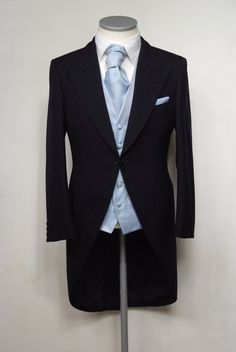 """Navy blue herringbone grooms morning suit. Choose from our wide range of wedding waistcoat's in a variety of styles. Mens sizes from 32"""" chest upward and include extra short, short, regular, long and extra long fittings. Boys sizes from 20"""" chest to 34"""" chest. Complete outfit includes jacket, trousers, hire or matching waistcoat, brand new traditional or French wing shirt in white or ivory, tie or cravat, braces and cufflinks. £125.00 to hire #groom #wedding #suit #suithire #waistcoat #navy"""