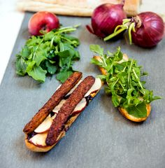 Tempeh Bacon Baguette with Caramelized Onion, Arugula, and Curried Apples