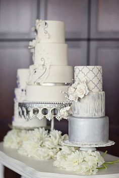 pretty white and silver cakes---I love the look of cakes en masse, especially these sleek silver and white ones.