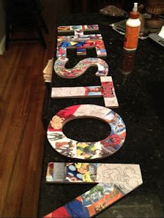 Card board letters mod podged with super hero pictures---I'd like to do this