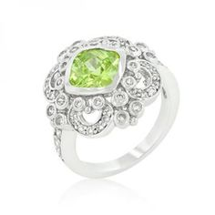 Genuine #Rhodium Plated Elegant Peridot Green Filigree Crest #Ring with Cushion Cut Peridot Green and Round Cut Cubic Zirconia Accents Polished into a Lustrous Silvertone Finish. This elegant crest ring features peridot green and clear cubic zirconia.