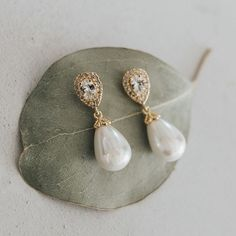 """I have hunted high and low for pearl earrings for my wedding day and these are just what I wanted! Very sparkly, I love them!""⠀ Style name: Ambrosia CZ and teardrop pearl earrings (gold)⠀ ⠀ Also available in silver. Teardrop Pearl Earrings, Black Pearl Earrings, Pearl Earrings Wedding, Bride Earrings, Pearl Studs, Vintage Earrings, Crystal Earrings, Pearl Jewelry, Bridal Jewelry"