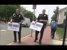 """Watch What Happens When Two Cops Offer People 'Free Hugs' - 17 May 2015 #HugACop What happens when two police officers walk down the street with signs that say """"Free Hugs""""? The Newark Delaware Police Department released a heartwarming video  that answers that question. Video:https://www.google.com/webhp?sourceid=chrome-instant&rlz=1C1AVNE_enUS632US632&ion=1&espv=2&es_th=1&ie=UTF-8#q=youtube%20free%20hugs%20hug%20a%20cop&es_th=1"""