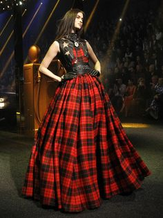 Checks: From Scottish tartan to plaid and colours such as green, red, blue, black or whatever you fancy, checks are back in vogue. Don't just stick to shirts when you can experiment with checked skirts, dresses and pants. We love this long dress spotted at Philipp Plein's show at Milan Fashion Week last week.