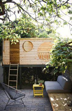 Modern backyard circle playhouse