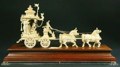 Ex. rare Ivory Kuruksherta Chariot, India, C.1800 - Carved Ivory Kurukshetra Chariot, horse drawn from India. The carriage is intricately hand carved in a classic Indian style. Major features include a turreted carriage canopy, full body sculptures of Arjuna and Krishna and four magnificent horses, all well sculpted. Krishna Statue, Krishna Art, Temple Design For Home, Phoenix Bird, Horse Drawn, Oriental, Indian Style, Pottery Art, Les Oeuvres