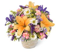 This comforting bouquet brings to mind a healing walk through a garden in bloom. A variety of seasonal flowers are selected and arranged in a sweet basket
