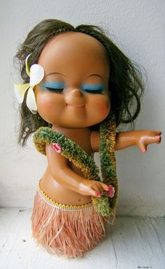 This Hawaiian doll is a cute exotic beauty! She comes in her original lei and grass skirt and has a plastic flower in her hair. The flower has