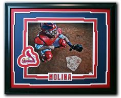 Yadier Molina. St. Louis Cardinals.  Custom framed 16x20 autographed photo in a 24x30 frame. St. Louis Cardinals embroidered patch mounted.