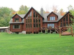 LUXURY LOG HOME that offers an indoor & outdoor paradise on the majestic Wisconsin River, sitting on nearly 3.5 acres with almost 300' of frontage & sandy beach. Massive Great Room with cathedral ceiling & expansive windows on the prow facing the river. Gourmet kitchen with 2 granite covered islands & stainless steel appliance package including double oven & wine chiller. Main floor master suite & additional bedrooms with bathroom suites with views of the river.