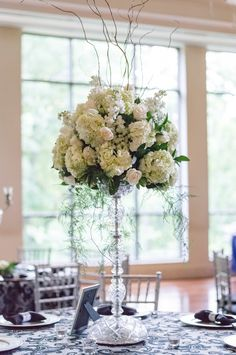 Sophisticated Tall Silver Candelabra Centerpieces | On Occasions of Atlanta, LLC https://www.theknot.com/marketplace/on-occasions-of-atlanta-llc-roswell-ga-814799 | Bamber Photography https://www.theknot.com/marketplace/bamber-photography-dayton-tn-360372 |