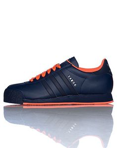 adidas low top sneaker Lace up closure Triple adidas stripes on sides Cushioned inner sole for comfo... True to size. Leather. Navy D74118.