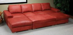 Available in high quality Elmo leather, this sectional sofa and ottoman combination from Design NS offers versatile seating solutions for a .
