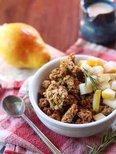 Oats are drenched in sweet maple walnut butter and mixed with savory rosemary before being baked up to a crisp to make this hearty fall rosemary granola.