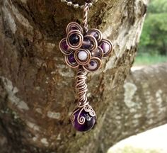 Spiral Tree of Life Pendant atop a Beautiful by TheSleepyFirefly
