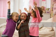 Stock Photo : Girls singing into microphone together