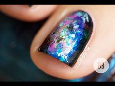 VIDEO TUTORIAL :: Tutoriel Nail Art | Galaxy Nails #1 by #blogenbeaute :: 1 coat Base Coat, 2 coats Essie Dive Bar, the following: a shimmery med blue, a light teal/mint green creme, a dark lavender creme, a dark pink creme, Orly Mermaid Tale (glitter polish)...these are dabbed onto the nail then dabbed w/ a piece of makeup sponge held in tweezers. Top Coat of Essie Good to Go :: CLICK for more pix on the blog!! LOVE THIS!