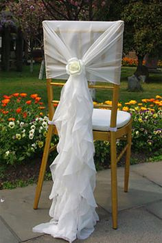 Modern looking chiffon chair sashes. The rose is a nice touch. (scroll down to #10 on the page).