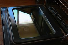 How to Clean Greasy Oven Doors - my favorite cleaning solution, baking soda, to the rescue.  Just a quick sprinkle over the door and a scrub down with a soapy mild abrasive sponge will do the trick better than self cleaning ovens can do.
