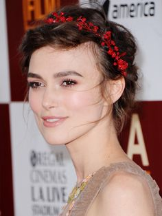 Keira Knightley's delicate, garland-like Chanel headband lends an ethereal touch to her tousled updo.