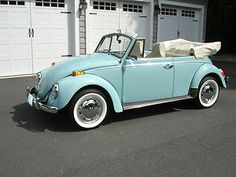 1970 Volkswagen : Beetle - Classic Convertible.  Ours was yellow.  We drove it on our honeymoon <3