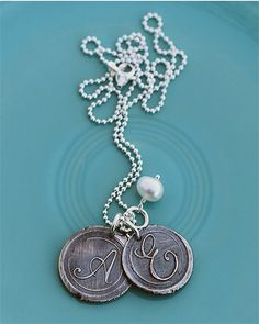 vintage silver charms necklace - the vintage pearl base price with 1 charm is $52 each additional letter is 25 dollars.  These are hand-stamped though.