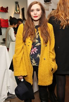 Mellow yellow: Elizabeth Olsen attends the AG Cher Coulter Event during Fall 2013 Fashion Week at Scoop NYC on Thursday