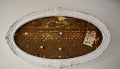 ceiling tin in an old frame for a magnetic board