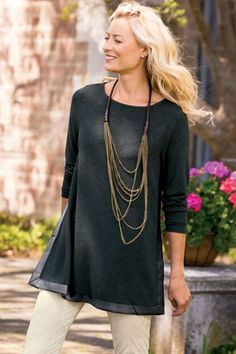 Style our Leather Trim Top for fall with your favorite necklace and slacks or leggings.
