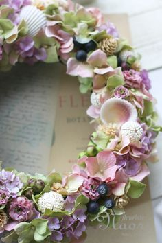 Pretty with the shells and flowers.