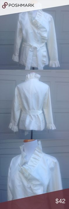 """NWOT Calvin Klein Ivory Ruffle Jacket - Size M Ivory, ruffle neck, tie waist, inside button, button down, ruffle around wrist, lined, extra button packet still attached to inside of jacket. New without tags. 49% Nylon 51% Polyester. Measurements are approximate and measured flat: chest 18"""" shoulders 15"""" arms 21"""" length 24"""" Calvin Klein Jackets & Coats"""