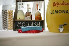 Having an array of drinks like this at tables sounds cute.