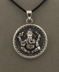 Antique-finish sterling silver Ganesh pendant made in Nepal with Om symbol on reverse side. Beautiful weight of 16 grams, great for spiritual style and positivity.