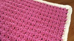 This easy crochet baby blanket is inspired by doing double crochets in the gap spaces between the double crochets in the row below.