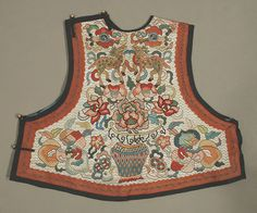 Woman's Vest from China. Late 19th century. The silk embroidery on this small rare garment is made of brick stitch and weave stitch of lustrous silk completely cover the ground. Patterning on the back side is the same, but there is some light staining near the shoulders,