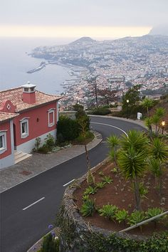 LIFE | TRAVEL | TAKE MONDAY OFF -  A Long Weekend in Magical Madeira |  Drink in the scenery, seafood and, of course, the sweet wine in four days on this lush Portuguese island off the coast of North Africa. Funchal at dusk, seen from Palheiro Village. @wsj