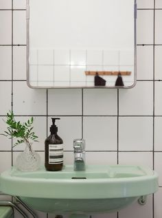 A Swedish home in a former shop - a green bathroom suit. yes please