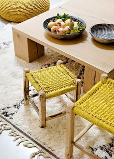 Mustard woven stools and wood coffee table