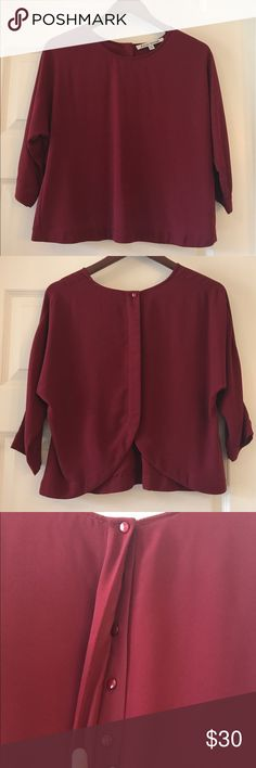 Lovers + Friends Burgundy Top Cropped burgundy blouse with 3/4 length sleeves from Lovers + Friends. Super cute button up detail on back. Like new, worn once or twice. Lovers + Friends Tops Blouses