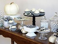 Black & White Halloween Table: Hosting a Halloween party is even sweeter with these elegant ideas for a dessert table display.