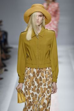 A nod to seventies sunshine at @maxmara. Dusty yellow prints and summer bombers in sumptuous silk. Beautiful. #MFW #SS15 #MaxMara