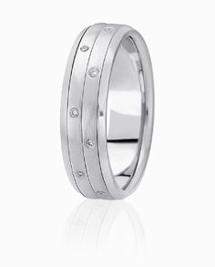 Diamonds Are Flush Set Into Two Bands Of Precious Metal In The Center Of This Fashionable Wedding Ring