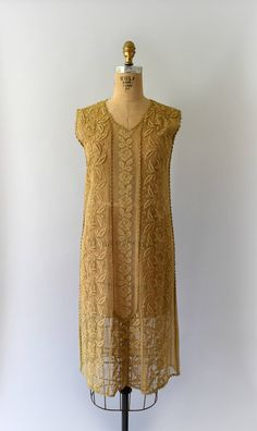 Exquisite 1920s antique lace dress, tea-stained tambour lace body, scoop neck, tank style shoulder, classic 20s straight flapper fit with a dropped waist and pull over styling. - - - M E A S U R E M E N T S - - - Fit/Size: XS/S Bust: 34 Waist: 34 Hips: 37 Length: 41 Maker/Brand: