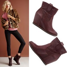Bootie with a hidden wedge, pull on tabs, detailed stitching and an almond toe.