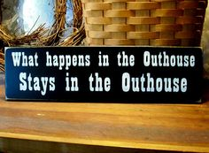 What happens in the Outhouse Wood Bathroom Sign Funny Wall Decor on Etsy, $12.00