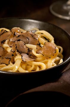 Hand-made pasta with shaved black truffles and butter, a classic dish from Alba's Truffle Festival in Piedmont.