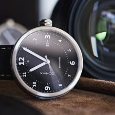 Stinson Swiss-crafter automatic watch. Comes with Wolf Designs' watch winder. Between $1,000 and $1,400