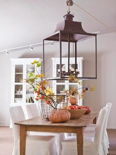 light gray walls, white chairs, wood table.  this will be my dining room soon :)